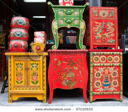 "This is a good example of traditional Chinese furniture. The furniture has painted dragons and flowers. You see a lot of the color ""red,"" which is a popular color meant for good luck."