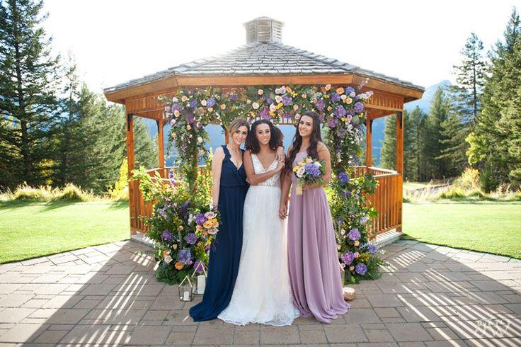 bridal party at the Silvertip wedding gazebo captured by Calgary wedding photographer Tara Whittaker | Canmore, Alberta