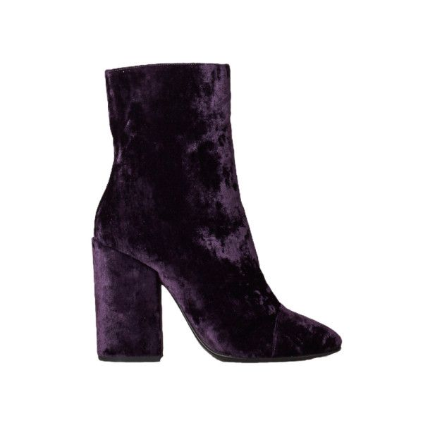 """Totokaelo - """"I love Totokaelo. They have a lot of unique designer pieces, the stuff that the larger department stores don't buy—the cool stuff. These purple Dries boots I've been eyeingare a perfect example."""" — Samantha Corbett, Graphic Designer"""