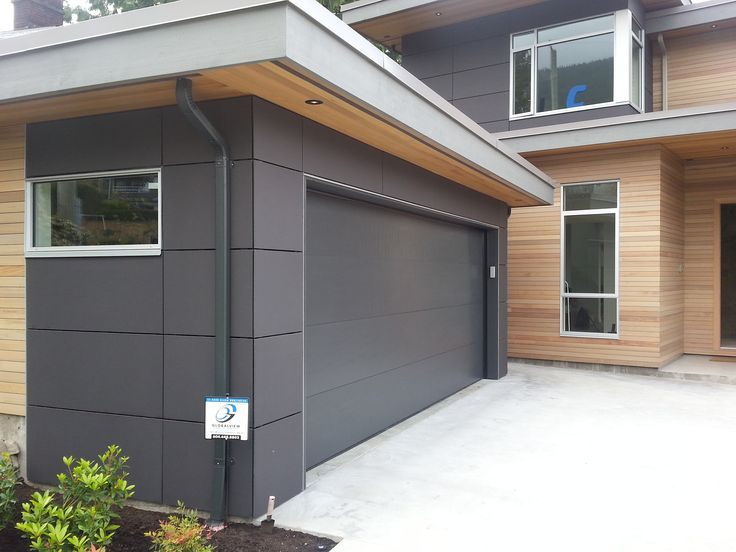 Modern Custom Home | Architect: TBC | Product: EQUITONE [natura] | This residence combines the use of flat, straight lines and EQUITONE fibre cement. The panels were installed with a concealed-fastening method, producing a clean finish per the homeowners vision. #brilliantbuildings