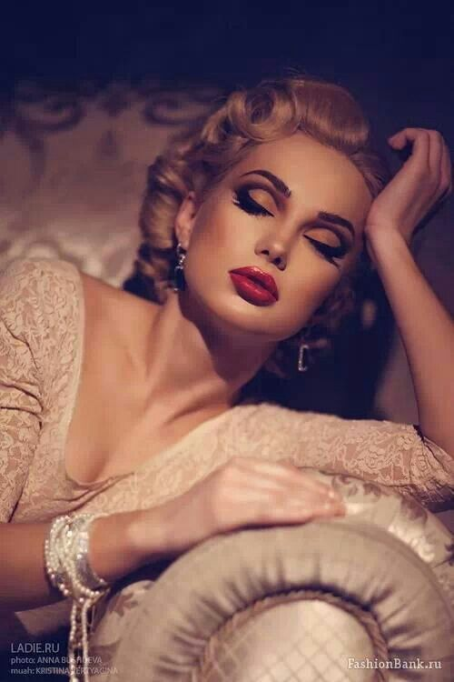 20's makeup-heavy cut crease paired with a red lip and strong contour. Very dramatic makeup