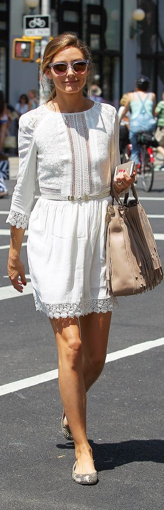 Olivia  Palermo kept her daytime look demure in a white frock and feminine flats.