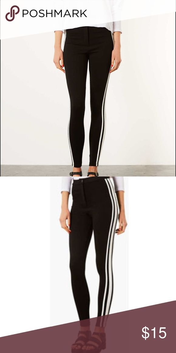 Thick black leggings with stripes on the side Tick quality black leggings with three white stripes on the side. Never worn! Topshop Pants Leggings