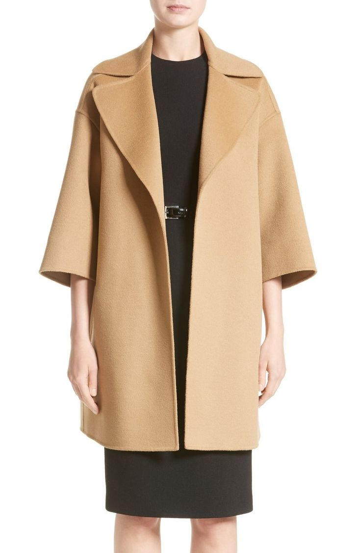 This three-quarter-sleeve coat embodies timeless elegance in an open-front clutch silhouette cut with dropped shoulders and an oversized notch collar.