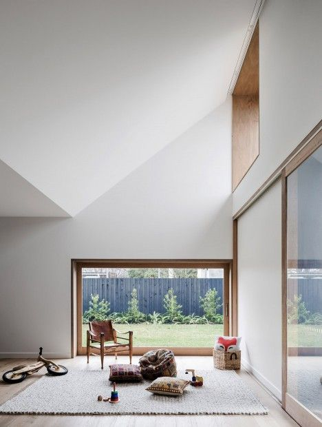 simple materials and the vaulted ceiling help to make a small space feel so much bigger.