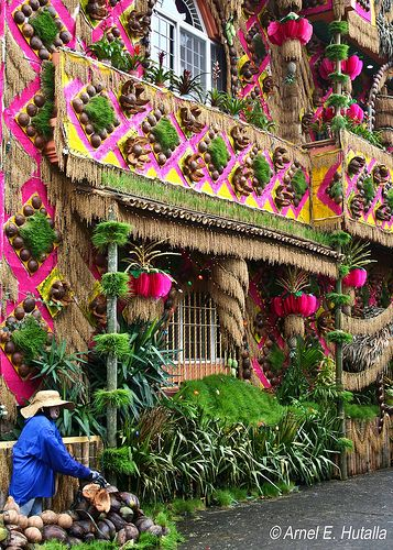 Pahiyas Festival - Quezon, Phillipines. Wow! The crowd.  Hospitality at its best - I had dinner at probably 5 houses, whose owners I didn't even know.  Houses are decorated with colorful rice wafers.  Must see!