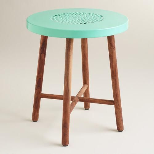 Bring a hint of color to your outdoor area with our feminine stool. Featuring a light blue pierced metal seat and acacia wood legs, this mixed-material stool complements many of our dining and occasional collections.