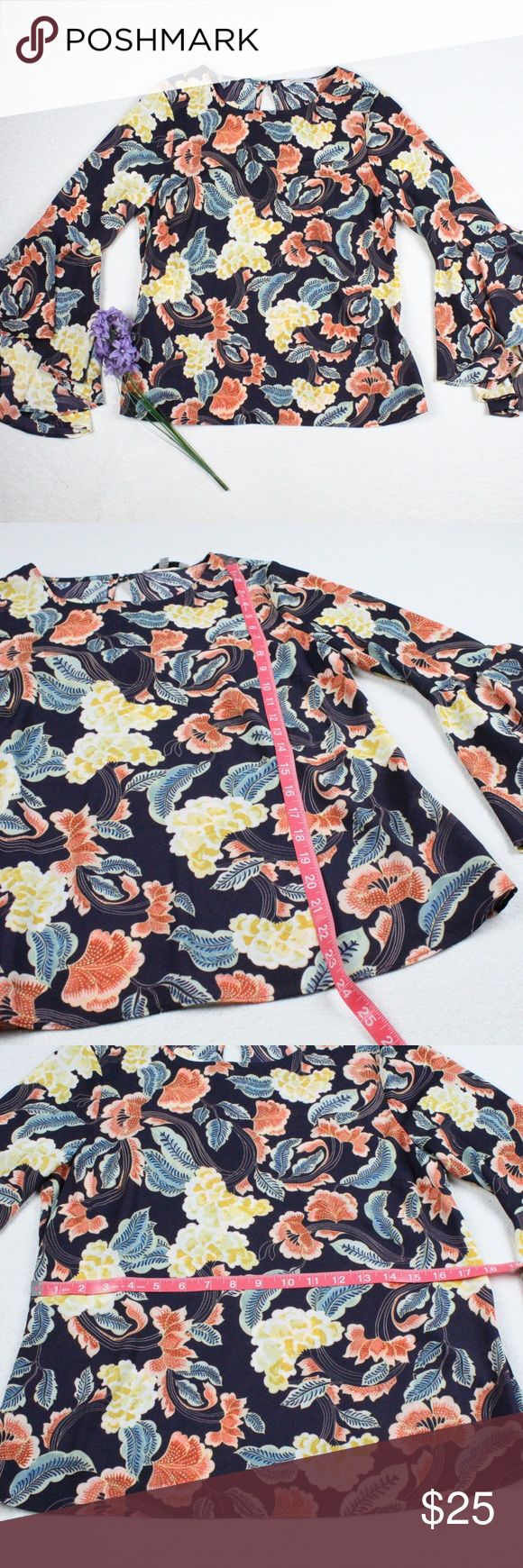 Navy Multicolor Floral Bell Sleeve Loose Blouse Preloved Bell sleeve floral print blouse Loose fit High scoop neckline A bit sheer so i'd recommend a cami This is a perfect top to pair with your favorite pair of denim jeans!!  100% Polyester. Please see photos for measurements.  Feel free to make an offer via offer button only. NO TRADES Tops Blouses