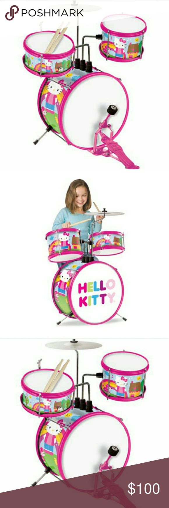 Sanrio Hello kitty drum set includes everything Almost new! My daughter didn't play it much. She's more of a flute and piano kinda girl. Great for Rockin' out! Everything included except girl. Sanrio Other
