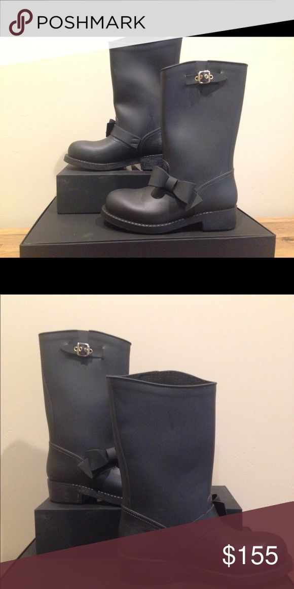 RED Valentino Bow Trim Black Boot RED Valentino Bow Trim Waterproof Rain Boot In great pre owned condition with a few exterior scuffs RED Valentino Shoes Winter & Rain Boots