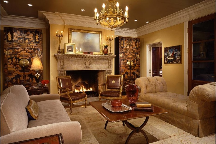 opulent living room design with ornate fireplace