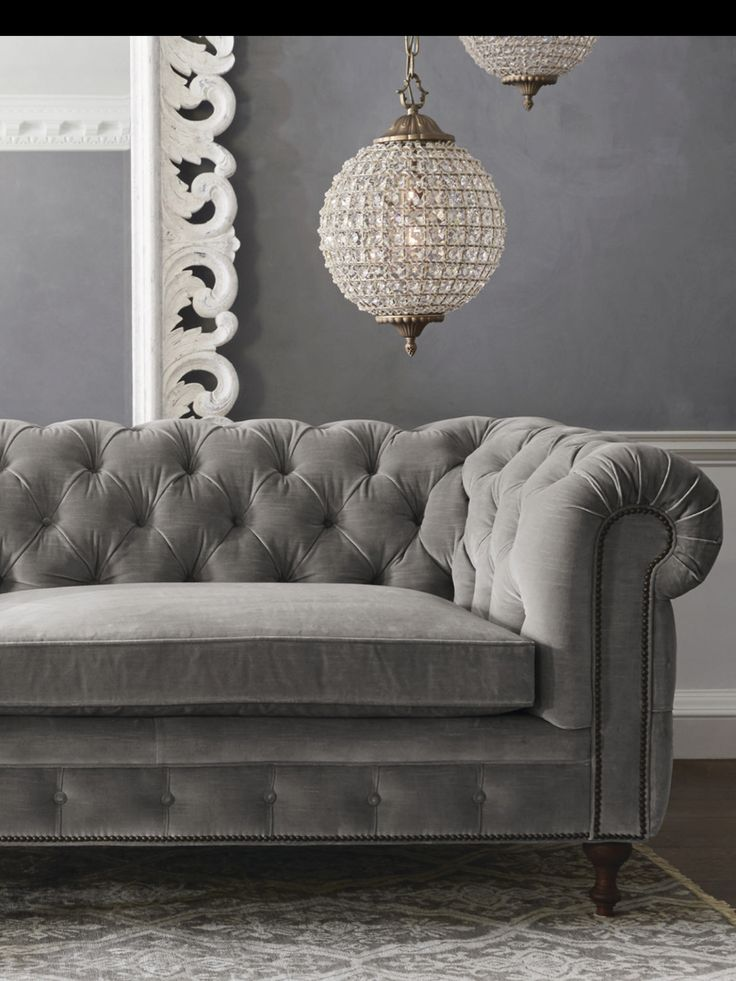 Grey tufted sofa