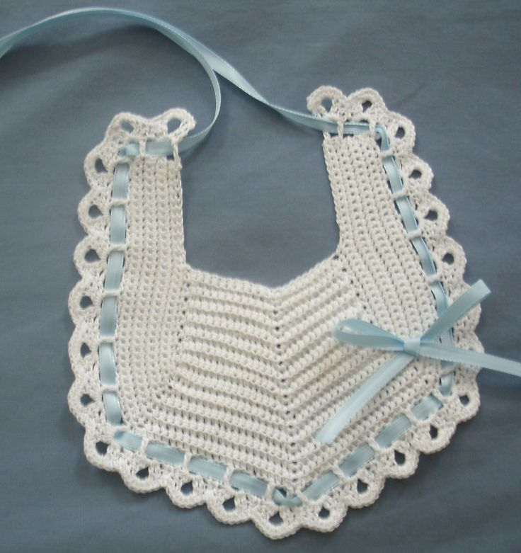 Baby Bib in White with Light Blue Hand Crocheted Baby Bib is made in White cotton thread with interwoven Light Blue ribbon and bow. Created in the USA. PH-1381 $23.50 + S/H