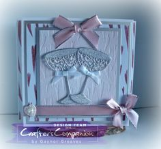 Card made using Crafter's Companion Catitudes Falling Hearts Embossing Folder, Champagne Glass Dies and Paper Pad. Designed by Gaynor Greaves. #crafterscompanion