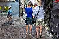 Old Couple Walking on Pedestrian Street in Town Center, Perpignan, South of France,