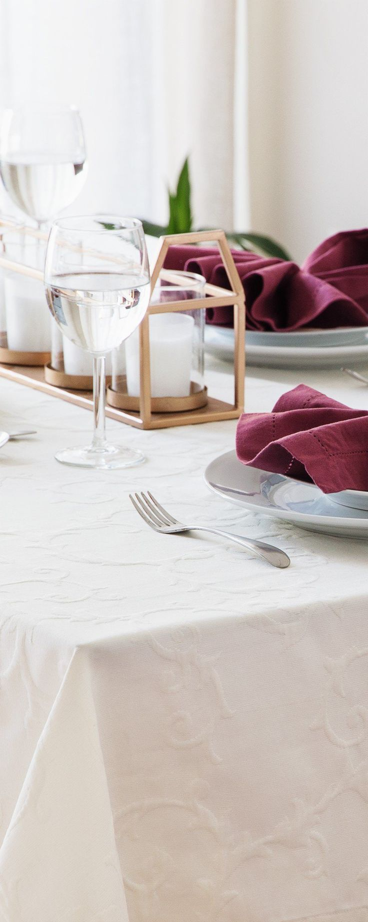 Mode Living- Stain-Resistant Tablecloths - Dress your table in luxury linen that's resistant to stains. Its fluorocarbon finish repels wine, oil and more—so they won't set in.