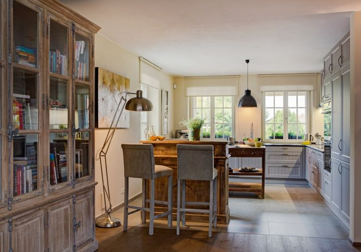 Provence kitchen with antique industrial bar with Ebolicht lights.