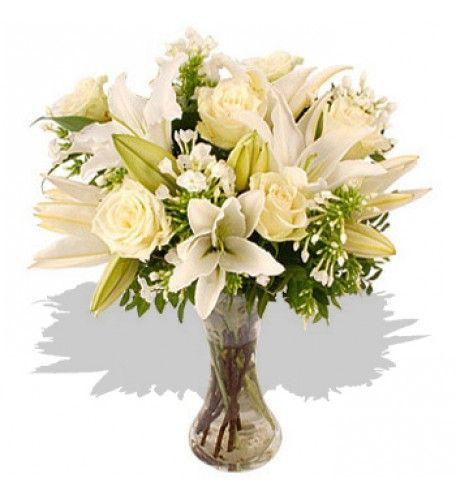 An elegant white bouquet made with seasonal white Phlox, Lilies and Roses. Simply beautiful.