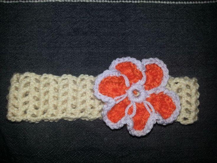 Crochet hairband with a crochet flower.