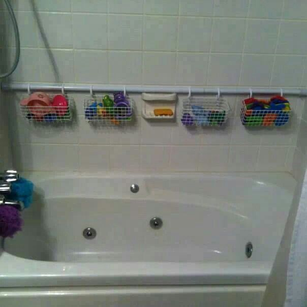 Baskets in a shower curtain rod for toy storage. ..brilliant!