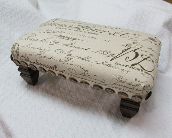 French Script Pouf... Think I'll recover my ottoman in this fabric!!!