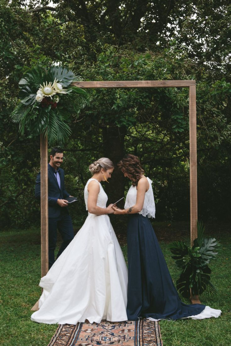 3 Things You Can Do To A Woman Lesbian Wedding - the contrast between the white and the black dress, and that arbor Wedding Goals, Wedding Attire, Dream Wedding, Wedding Dresses, Wedding Hair, Lgbt Wedding, Lesbian Wedding Photos, Lesbian Wedding Photography, Rainbow Wedding