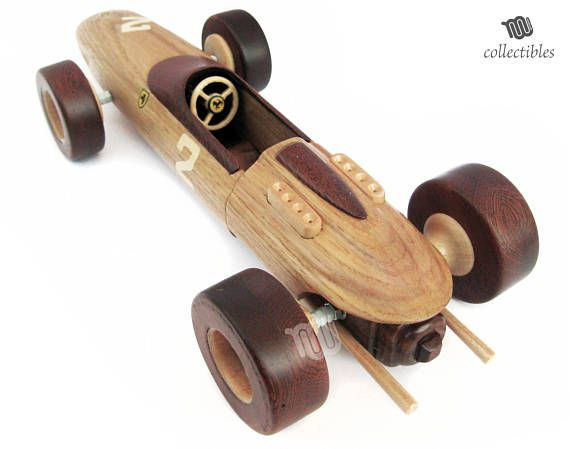 Wooden replica of a classic italian racing car: Ferrari F1 158 of 1964s. [historical fact] The Ferrari 158 was a racecar made by Ferrari in 1964 as a successor to the V6-powered Ferrari 156 F1 that had dominated in 1961 but become outdated by 1962. As with the British competition, it