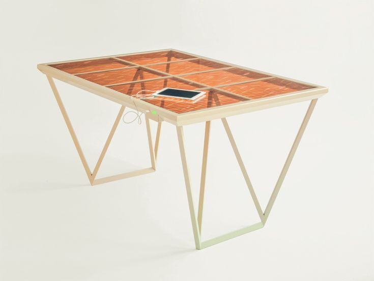 photosynthesis-based table by marjan van aubel harvests energy and powers devices