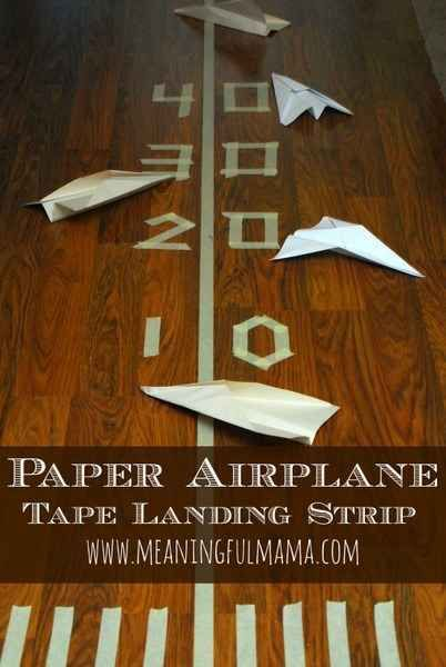 You can also use tape to make a paper airplane landing strip.