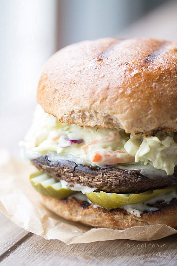 Grilled portobellos with a creamy avocado slaw are sandwiched between grilled whole wheat buns - healthy and delicious, too.