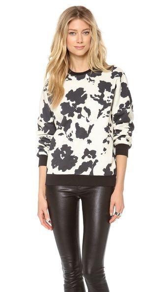 MSGM Cow Print Sweatshirt $399