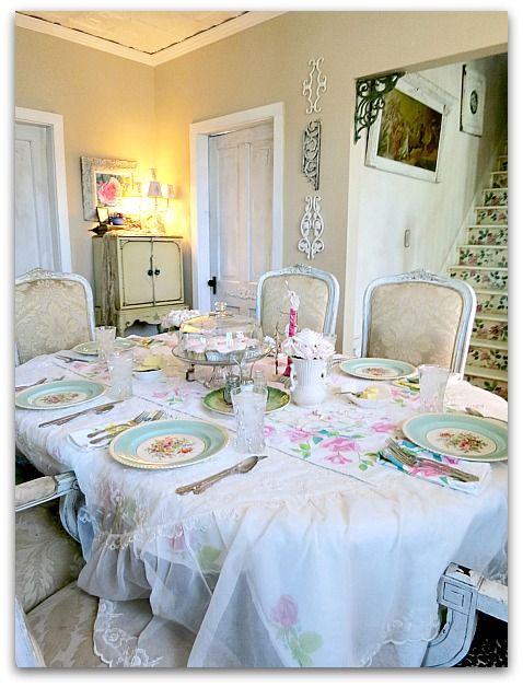 All of my table cloths are from garage sales, and some are in better shape than others. By layering them all on top of each other, no one noticed the stains or holes. At least that was the plan. Plus, I like the sheer, lacy cloth over the rose patterned one, it makes it a lot more lush.