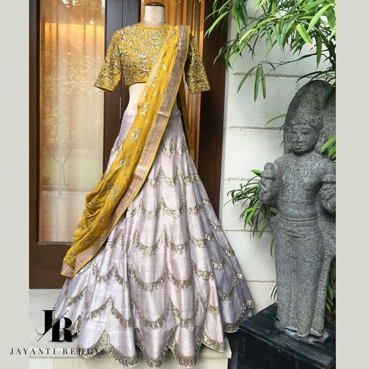 Mustard X Beige.A beige scalloped lehenga contrasted with a mustard blouse and dupatta!Jayanti Reddy Art Design . 13 December 2017