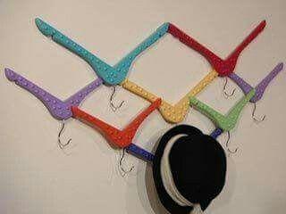 Wood hangers repurposed as a hat rack