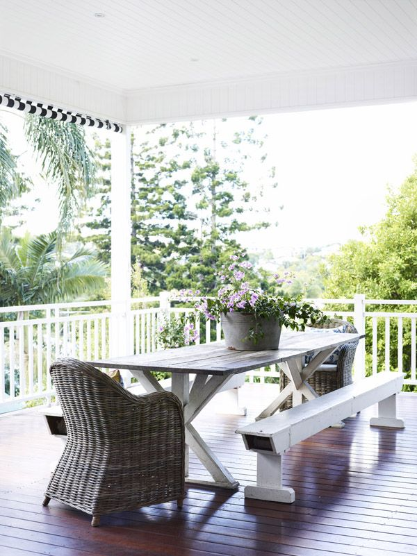 Beautiful outdoor dining area adjacent to kitchen. Photo - Toby Scott, production – Lucy Feagins / The Design Files.