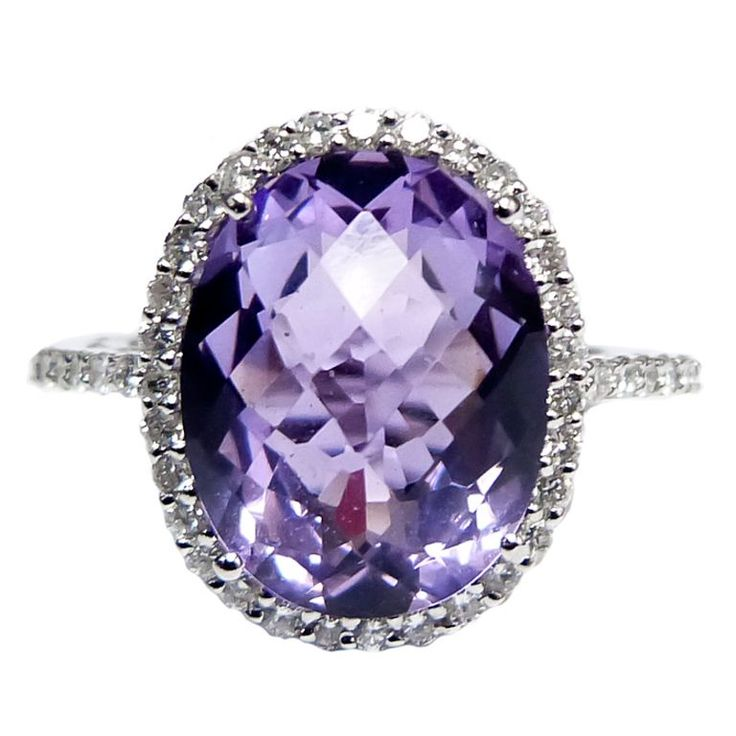 18K Purple Amethyst Diamond Ring This beautiful cocktail Ring, features 6.28 Carat Fine quality purple Amethyst in the center, surrounded by 0.50 carats of round Brilliant cut Diamonds.