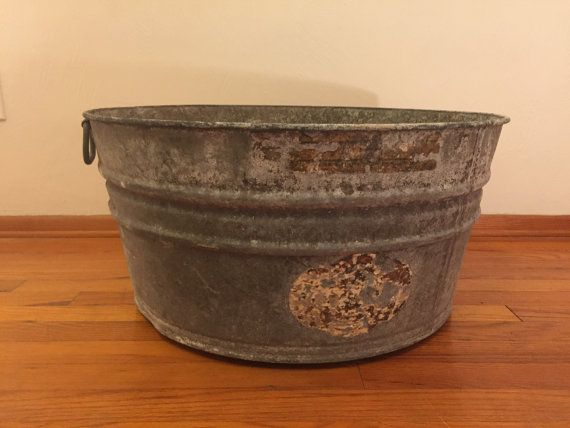 Extra large vintage galvanized tub, size 3. In good condition but does have some rust. Great for plants, as christmas tree holders, beer barrel at your next gathering, or a log holder by the fire place. Dimensions: 24 1/2 round x 11 3/4 H  Local Pittsburgh pickup or delivery is available.