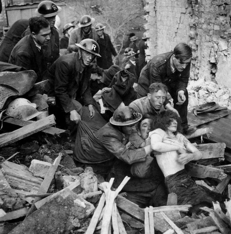 """""""British Air Raid Wardens and civilians help to pull an injured English woman from the rubble following a German Luftwaffe air raid on London during the Blitz. Starting on 7 September 1940, London was bombed by the Luftwaffe for 57 consecutive nights. Over a period of 267 days (almost 37 weeks), London was attacked 71 times and there were aerial raids on 16 other British cities, some bombed multiple times. London, England, U.K. October 1940."""""""