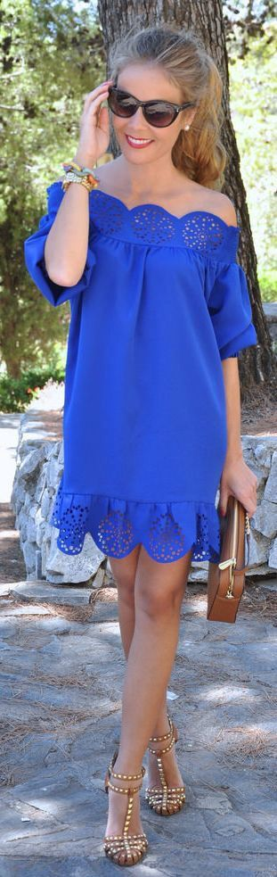 Like the color and cutout scalloped detail!  (Not crazy about the peasant style).  Also those shoes are awesome!