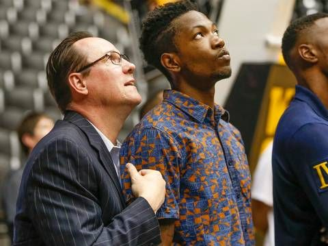 Wichita State coach Gregg Marshall watches the highlights video on the big screen with freshman Zach Brown at the WSU basketball awards celebration at Koch Arena Thursday. (April 16, 2015)