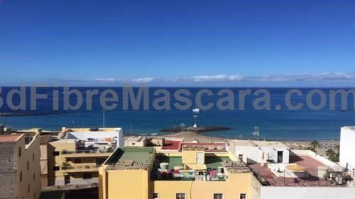 Barrio Azul Arona Set 700 metres from Playa de las Americas and 44 km from Puerto de la Cruz, Barrio Azul offers accommodation in Arona. The unit is 600 metres from Los Cristianos. Free WiFi is provided . The unit is equipped with a kitchen.
