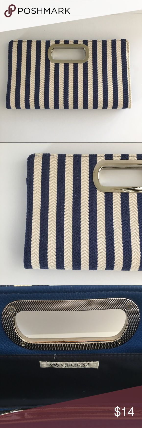 Versona Navy and Tan Striped Clutch. Silver Handle Versona Accessories Classic Navy and Cream Striped Clutch. Excellent pre-owned condition. Versona Bags Clutches & Wristlets