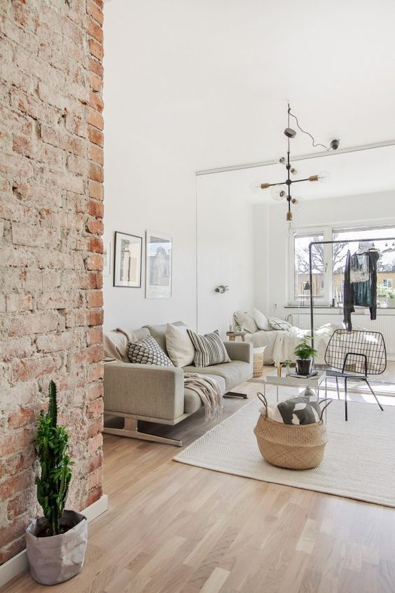 Modern bright living room with exposed brick accent wall @pattonmelo