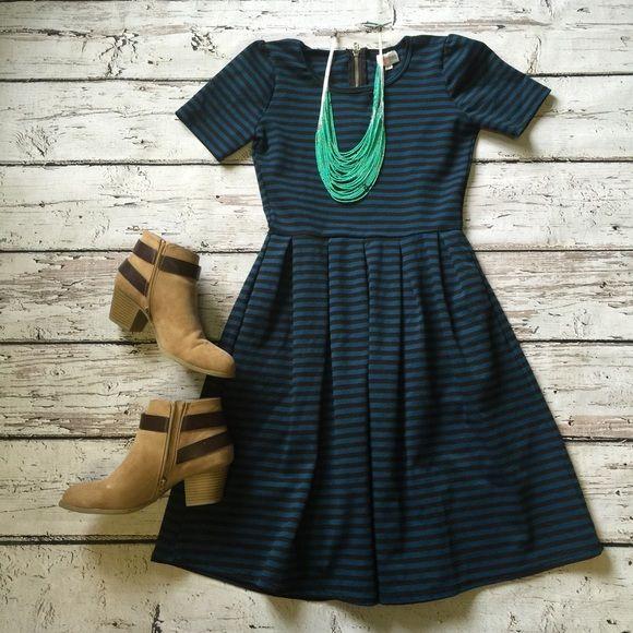 Lularoe striped amelia dress xs Blue and black striped amelia dress from LuLaRoe. Has an exposed back zipper and pockets. Xs fits up to a size 6. Some minor pilling. Lularoe Dresses Midi