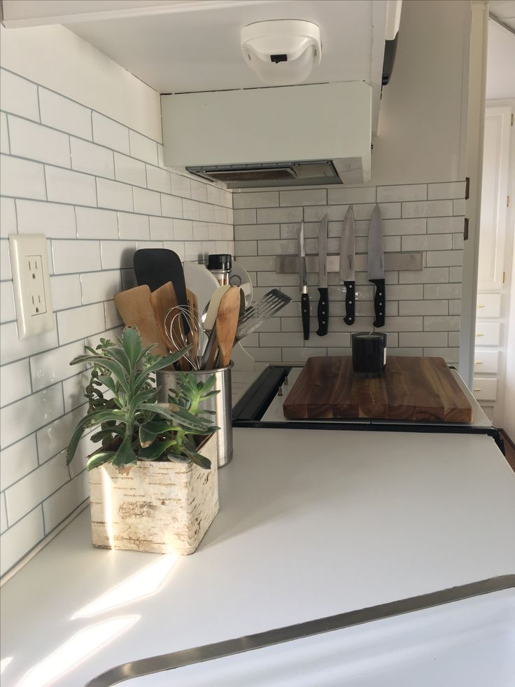After! Our 4 week fifth wheel makeover. Peel and stick tiles DIY camper remodel #ideas #DIY #makeover #fifthwheel #camper #style