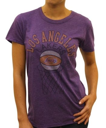 Women's Los Angeles Lakers Shirt by Junk Food  This officially licensed Women's NBA shirt by Junk Food features a Los Angeles Lakers basketball going through the hoop along with the year the team was established.    Fabric Details        Color: Dark Grape      50% cotton / 50% polyester    Our Price: $25.95