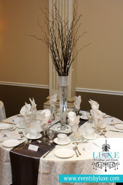 Silver, Wedding Centerpieces Photos in All Areas. Photos Albums. Filters. Apply. Clear. Colors Any. White Hydrangea and Orchid Centerpiece. Stately Ballroom Reception. Silver Wedding Reception Decor. Tall Feather Centerpieces. Silver Vase Floral Arrangements With Pale Pink Roses.