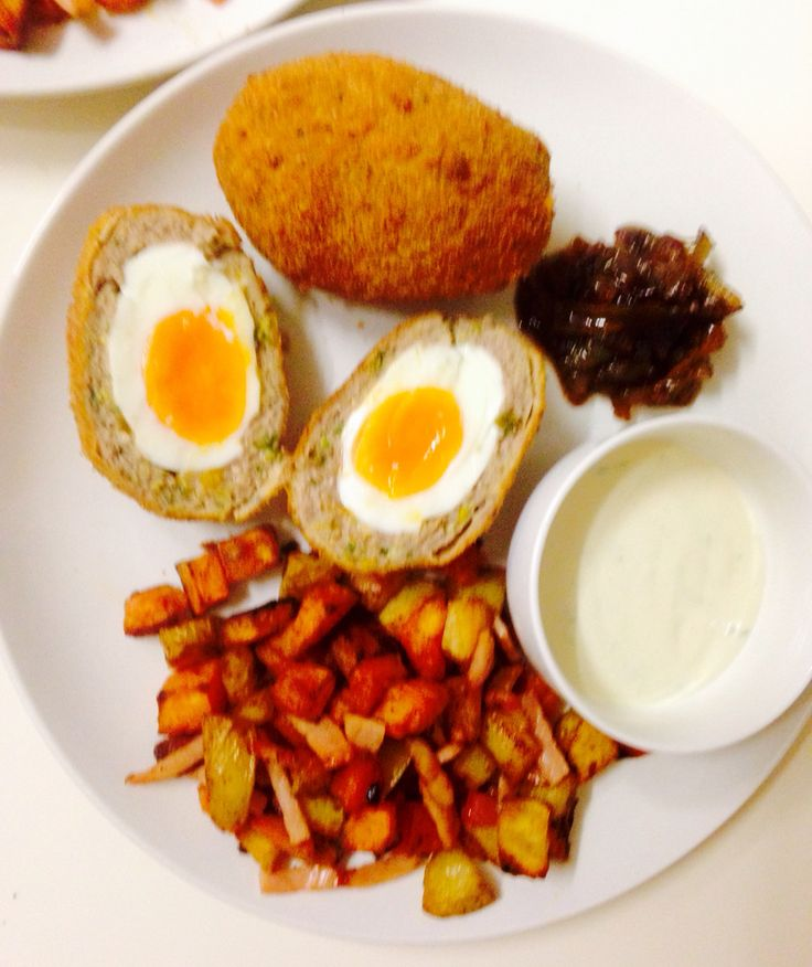 Scotch eggs with English style hash browns, caramelised onion and mustard sauce
