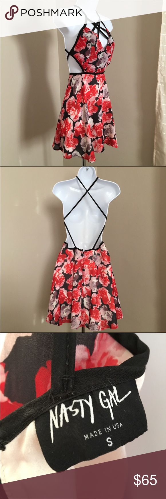 Backless Floral Strappy Nast Gal Mini Dress Barely worn, perfect condition. Beautiful and flattering fit. Moves very well and is great for dancing. Fits a size 2-4. Nasty Gal Dresses Mini