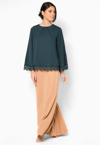 "Aria Isadora Baju Kurung ""The dark green top is accented with front pleats and delicate lace trims, while the skirt is kept minimal with back pleated details."""